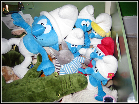 Smurfs in the toy box.